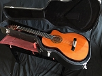 An Acoustic nylon string guitar with electric hookup